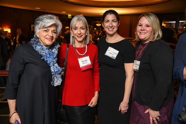 Amy Elias, second from left, the founder and CEO of Profiles Inc., celebrates her 2017 Daily Record Icon Honors award with Chickie Grayson, far left, president and CEO of Enterprise Homes Inc.; and Profiles colleagues Amy Burke Friedman, the company's president, and Jamie Watt Arnold, senior vice president. (Photo by Maximilian Franz)