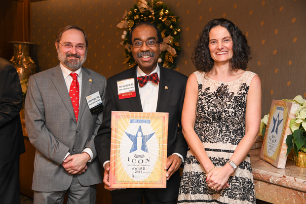 E. Albert Reece, MD, Ph.D., MBA, dean of the University of Maryland School of Medicine, displays his 2017 Daily Record Icon Honors award with James Kaper, Ph.D., the senior associate dean for academic affairs and professor and chair of its department of microbiology and immunology, and Suzanne E. Fischer-Huettner, publisher of The Daily Record. The University of Maryland School of Medicine was a 2017 Icon Honors awards sponsor. (Photo by Maximilian Franz)