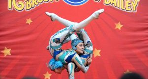 Mongolian contortionists Erdenesuren Damdimbayar and Nomin Nyamknuu from the Ringling Bro. &  Barnum and Bailey Circus perform for students from James McHenry Elementary & Middle School during a private event at the B&O Railroad Museum to promote its final tour with its Out of This World production. (The Daily Record / Maximilian Franz)