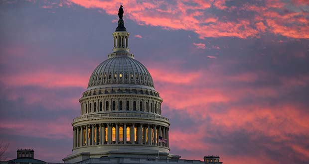 FILE - In this Thursday, Nov. 30, 2017, file photo, the sky over The Capitol is lit up at dawn as Senate Republicans work to pass their sweeping tax bill this week in Washington, (AP Photo/J. Scott Applewhite)