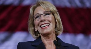 FILE - In this Oct. 13, 2017 file photo, U.S. Education Secretary Betsy DeVos speaks during a dinner hosted by the Washington Policy Center in Bellevue, Wash. DeVos is scheduled to stop in Baltimore to deliver a commencement address at the University of Baltimore. In recent weeks, some University of Baltimore students have protested the choice of DeVos as their fall commencement speaker. (AP Photo/Ted S. Warren, File)