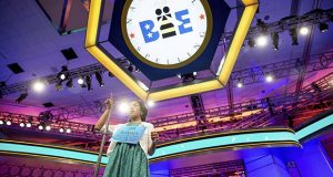 "FILE - In this May 28, 2015, file photo, Siyona Mishra, 11, of Orlando, Fla. gestures while trying to spell ""hacek"" during the finals of the Scripps National Spelling Bee at National Harbor in Oxon Hill, Md. The Scripps National Spelling Bee has announced a rule change that could result in the field of spellers nearly doubling, from fewer than 300 to more than 500. Previously, spellers had to win their regional bee to make it to nationals. For three years running, Siyona Mishra and Dhyana Mishra faced off amid some of the highest stakes in competitive spelling. They outlasted the rest of the field at the regional spelling bee in Orlando in 2015, 2016 and this year. But there was only room at the Scripps National Spelling Bee for one of them. Siyona finished eighth overall at nationals in 2015, but last year, she lost the regional bee to Dhyana _ the two are not related _ and had no way to return. (AP Photo/Andrew Harnik, File)"