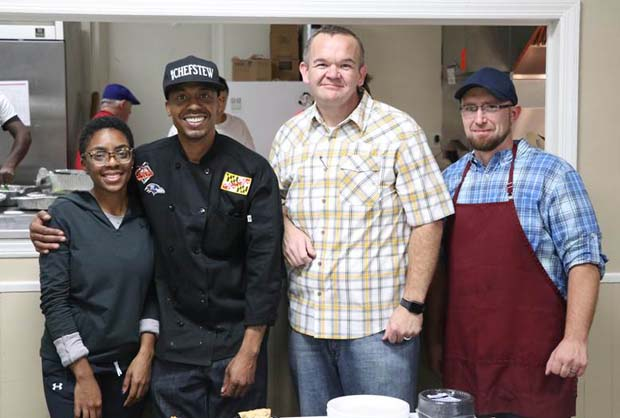 "Executive chef Robert ""Chef Stew"" Stewart, second from left, winner of the Food Network television show, ""Cutthroat Kitchen;"" takes photo with Kirsten Allen, a community affairs associate at Sagamore Development; Bill Humphrey, senior pastor at Pathway Church of God and executive director of the Baltimore Dream Center; and Keith Hunley, outreach and youth pastor at Pathway Church of God. (Photo courtesy of Port Covington development team)"