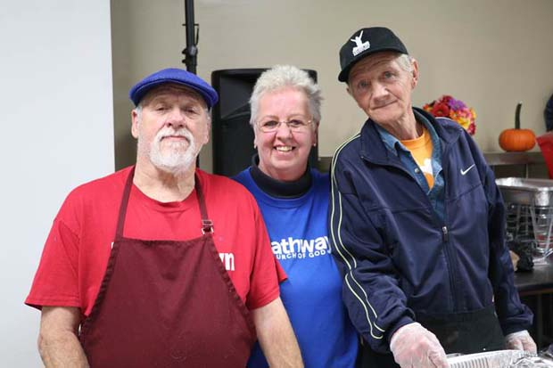 From left, Norman Jones, Sandra Greenstreet and Kyle Watson, all volunteers at the Baltimore Dream Center, helped deliver Thanksgiving meals to hundreds of south Baltimore residents during SB7 Coalition's Thanksgiving dinner event. (Photo courtesy of Port Covington development team)