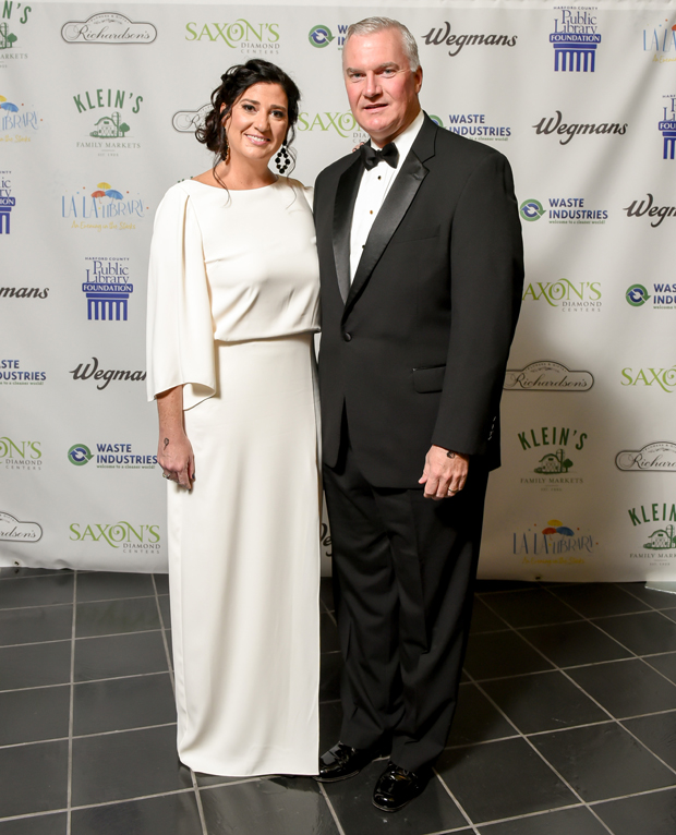 """Bryan E. Kelly, right, a co-founder and principal owner of Bel Air-based The Kelly Group, and his wife, Katherine, were honorary chairs of """"La La Library: An Evening in the Stacks,"""" an annual fundraiser for The Harford County Public Library Foundation. (Photo by Maximilian Franz)"""