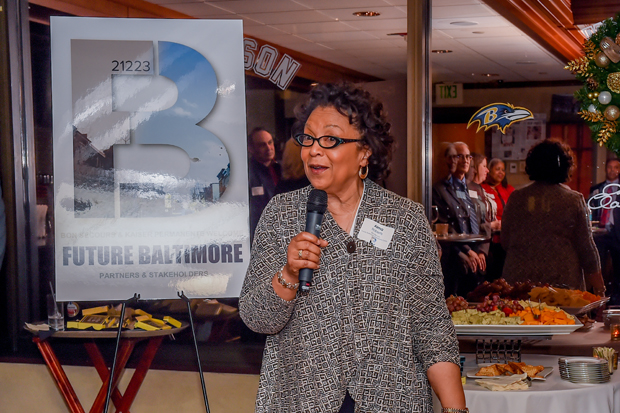 Alma Roberts, a senior program manager with Kaiser Permanente, addresses the crowd at The Center Club at the Future Baltimore holiday party. (Photo by Sharon Redmond)