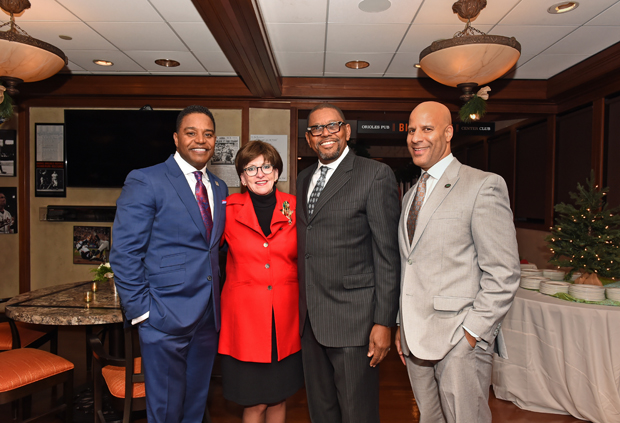 From left, Calvin Butler, the CEO of BGE; Julie Mercer, the vice president of philanthropy and development with Bon Secours Baltimore Health System Inc.; Harrison Boyd, the vice president and chief operating officer with ADC Management Solutions; and Chris Duncan, a manager-real estate with BGE, attended the Future Baltimore holiday party. (Photo by Sharon Redmond)