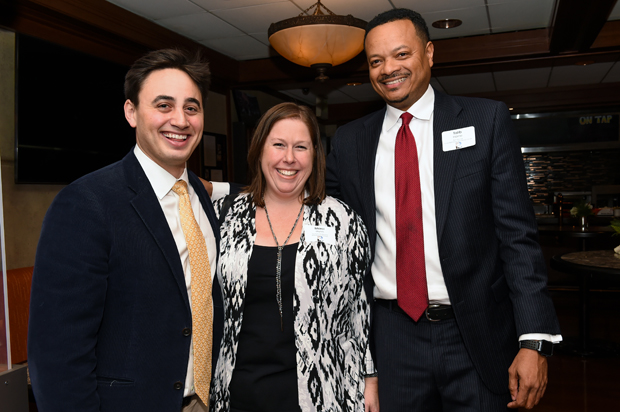 From left, Colin Smith, a special projects liason with Bon Secours Health System; Marci Hunn, a program director in workforce development with the Harry & Jeannette Weinberg Foundation; and Talib Horne, the executive director of Bon Secours Communty Works, enjoy the evening at the Future Baltimore holiday party. (Photo by Sharon Redmond)