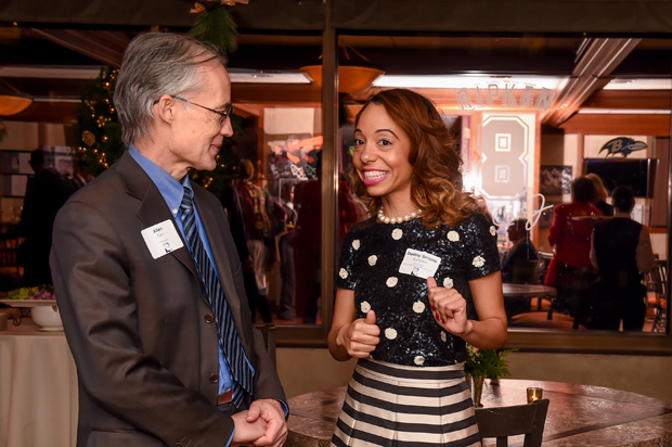 Allen Tien, left, the president and director of applied research with Medical Decision Logic Inc., enjoys a conversation with Destiny-Simone Ramjohn, a director in stakeholder relations with Kaiser Permanente, at the Future Baltimore holiday party. (Photo by Sharon Redmond)