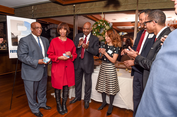 "Baltimore Mayor Catherine Pugh addresses partygoers with Baltimore City Council President Bernard C. ""Jack"" Young, left, Samuel L. Ross, M.D., the CEO of Bon Secours Baltimore Health System; and Destiny-Simone Ramjohn, a director in stakeholder relations with Kaiser Permanente, at the Future Baltimore holiday party. (Photo by Sharon Redmond)"