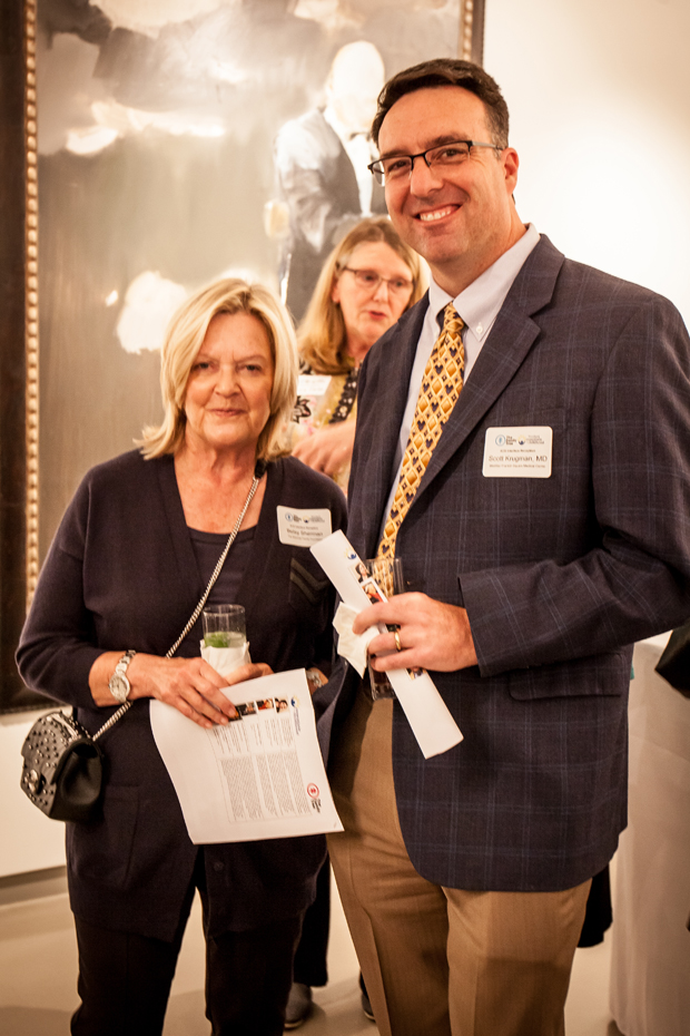 Betsy Sherman, left, a member of the board of directors with The Family Tree, gets a photo with Dr. Scott Krugman, chair of pediatrics at MedStar Franklin Square Medical Center, during the launch of the statewide ACE Interface Project. (Photo by Kat Ashdown)