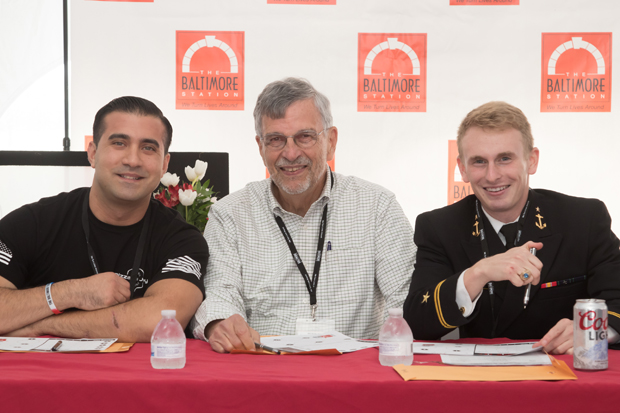 From left, Joey Vanoni, owner of Pizza di Joey and honorary chair of the Stars, Stripes and Chow Chili Cook-Off; Jerry Hazelwood, a compliance manager with Habitat for Humanity of the Chesapeake; and Lt. j.g. Nick Stovall-Kurtz, a Midshipman at the U.S. Naval Academy, were on hand for event at Port Covington's City Garage. (Photo courtesy of The Baltimore Station)