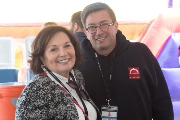 Connie Rogers, left, gets a photo with The Baltimore Station's Executive Director John Friedel during the Stars, Stripes and Chow Chili Cook-Off. (Photo courtesy of The Baltimore Station)