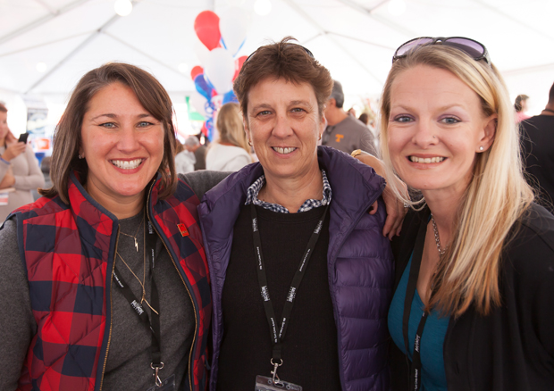 From left, Christie Walsh-Meyers, the vice president of The Baltimore Station's board of directors and chair of the the Stars, Stripes and Chow Chili Cook-Off; Kim Bowling, a senior manager in global store Development with Under Armour; and Bobbie Geisler, the owner of Shore Sounds, attended to annual fundraising event at Port Covington's City Garage. (Photo courtesy of The Baltimore Station)