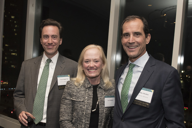 Michael Hankin, right, president and CEO for Brown Advisory, celebrates his Businessman of the Year award from Loyola Maryland University's Sellinger School of Business with his wife, Ann Hankin, and colleague Thomas Graff, a portfolio manager and head of fixed income for Brown Advisory. (Photo by Larry Canner)