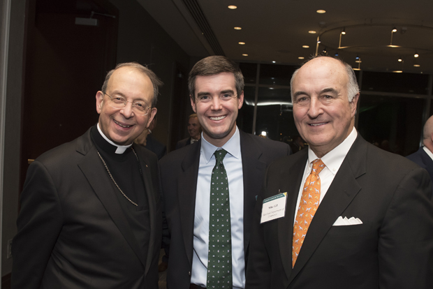 From left, William Lori, archbishop of the Archdiocese of Baltimore; Brady Walker, managing director and special adviser for the Maryland Department of Commerce; and Mike Gill, secretary of the Maryland Department of Commerce, attended Loyola University Maryland's Sellinger School of Business and Management's Businessman of the Year celebration. (Photo by Larry Canner)