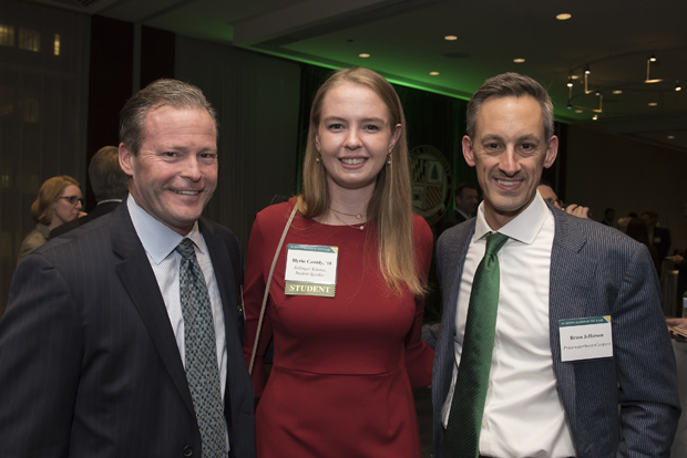 From left, Paul Nolan, vice president of tax and government relations for McCormick and Co.; Blythe Cassidy, speaker and student at Loyola University Maryland's Sellinger School of Business and Management; and Brian Jefferson, partner with PricewaterhouseCoopers, pose for a photo during Loyola University Maryland's Sellinger School of Business and Management's Businessman of the Year celebration. (Photo by Larry Canner)