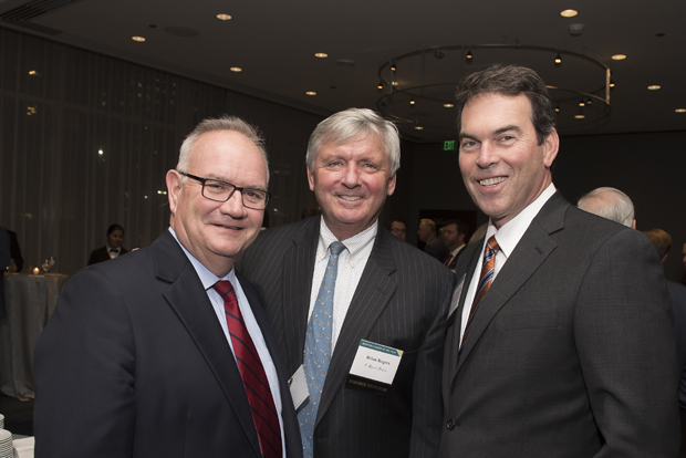 From left, Bill McCarthy, executive director for Catholic Charities of Baltimore; Brian Rogers, non-executive chair of the board of directors of T. Rowe Price and retired chair and CEO; and Mark Weigman, vice president and portfolio manager for T. Rowe Price, attended Loyola University Maryland's Sellinger School of Business and Management's Businessman of the Year celebration. (Photo by Larry Canner)