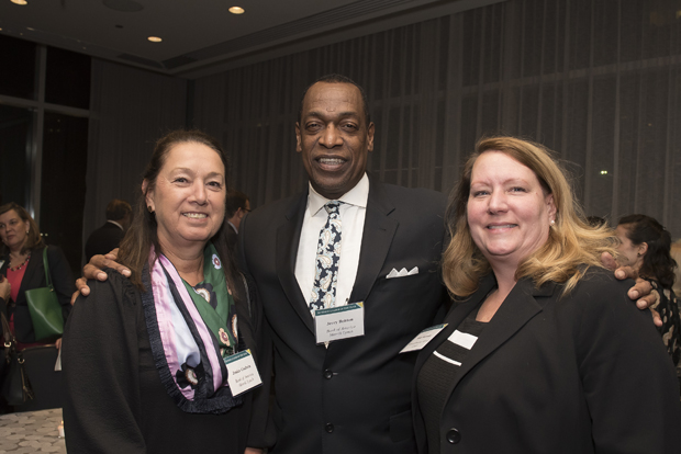 From left, Janice Godwin, senior vice president of Bank of America Merrill Lynch; Jerry Britton, vice president and senior financial adviser of Bank of America Merrill Lynch; and Kim Sherman, senior relationship manager for commercial banking at Bank of America Merrill Lynch, pose for a photo during Loyola University Maryland's Sellinger School of Business and Management's Businessman of the Year celebration. (Photo by Larry Canner)