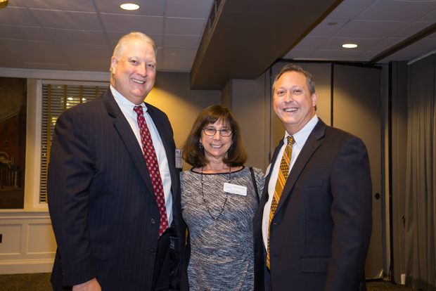Susan Erlichman, center, the executive director of the Maryland Legal Services Corporation, enjoys the reception with Judges Kent Boles, left, and Mark Scurti, both with the District Court of Baltimore City.