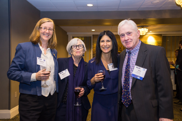 Michael A. Millemann, far right, a professor of law at the University of Maryland Francis King Carey School of Law, celebrated his winning the Robert M. Bell Access to Justice Medal at the Maryland Legal Services Corporation's annual awards reception with colleagues, from left, Maureen Sweeney, Deborah Weimer and Sara Gold. (Photo by Guill Photo Inc.)