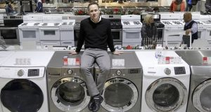 In this Wednesday, Dec. 20, 2017, photo, Jon Abt poses for a portrait on the sales floor of the Abt family's single appliance and furniture store in Glenview, Ill. Abt says his appliance and furniture store held its own this holiday season, up against competition like Amazon, Walmart, Best Buy and more, by capitalizing on advantages it has over the big guys. (AP Photo/Charles Rex Arbogast)