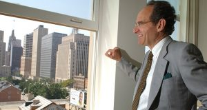 """David Hillman, Chairman and CEO of Southern Management Corperation, Looking out of an apartment window of his """" The Standard"""" complex at 501 St. Paul Street in Baltimore. MF-D 7/29/02."""