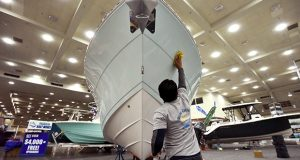 1-24-18 BALTIMORE, MD-  Photo of crew setting up the Progressive Baltimore Boat Show at the Baltimore Convention Center. Here Tito Martin with Blue Ocean Boat Detailing waxes a Cobia 237 in preparation for the show. (The Daily Record/Maximilian Franz)