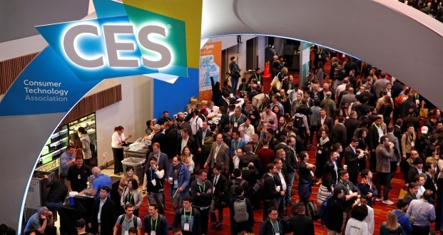 People attend CES 2018 on Tuesday in Las Vegas. (AP Photo/John Locher)