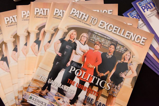 The Path to Excellence magazine is displayed during its January networking event at Hotel Indigo. (Photo by Maximilian Franz)