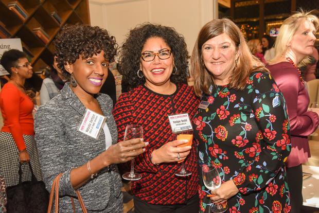 From left, Natasha Dartigue, a deputy district public defender in District 1 of the Maryland Office of the Public Defender; Monique Beutel, a compliance officer with UnitedHealth Group; and Darice Dixon, a senior account manager with The Daily Record, enjoy their time at January's Path to Excellence networking event at Hotel Indigo. (Photo by Maximilian Franz)