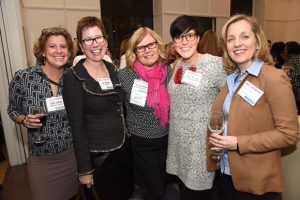 From left, Sarah Sullivan, a marketing consultant; Clare Berrang, director of the Tenant Advisory Group with Newmark Knight Frank; Terri Harrington, senior vice president with MacKenzie Commercial Real Estate Services; Kaitlyn Wernsing, development coordinator with the Maryland Volunteer Lawyers Service; and Pamela McGinnis, a financial and technology consultant with Glass Jacobson Financial Group, take time for a photo during January's Path to Excellence networking event at Hotel Indigo. (Photo by Maximilian Franz)
