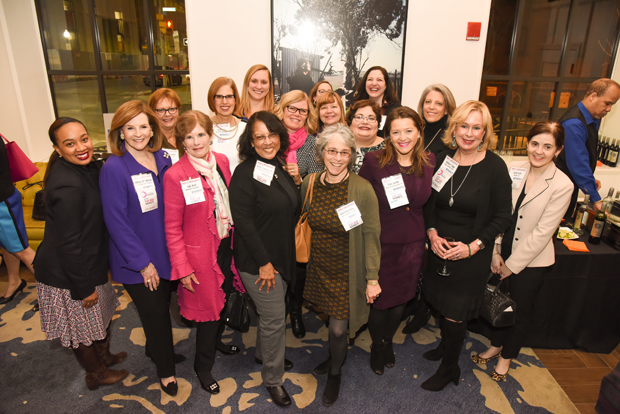 Past honorees of The Daily Record's Top 100 Women and Leading Women programs gather for a group photo at Hotel Indigo during January's Path to Excellence networking event. (Photo by Maximilian Franz)