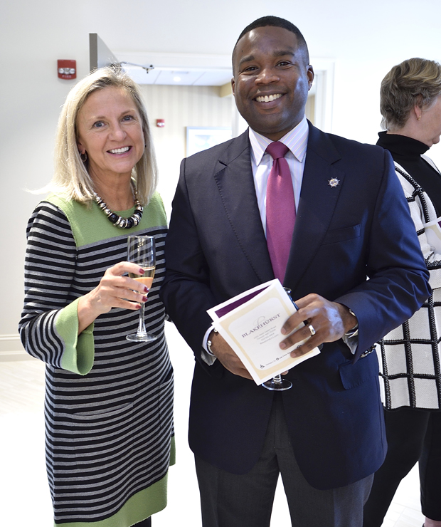 Karen Benckini, left, the media director with Clapp Communications, and Charles R. Conner III, ESQ, the Baltimore regional director of the office of U.S. Sen. Chris Van Hollen, enjoy their time at Blakehurst's ribbon-cutting opening in Towson. (Photo by Tom O'Connor Photography)
