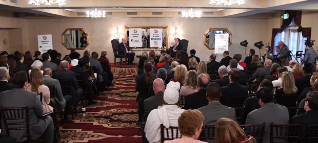 Radio talk-show host Marc Steiner interviews Gov. Larry Hogan while the crowd of more than 160 people listens during the 15th annual Annapolis Summit at The Governor Calvert House in Annapolis. (Photo by Maximilian Franz)