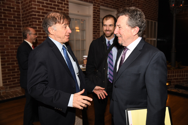 Vincent DeMarco, left, the president of the Maryland Citizens' Health Initiative, shakes hands with radio talk-show host Marc Steiner at the 15th annual Annapolis Summit. (Photo by Maximilian Franz)