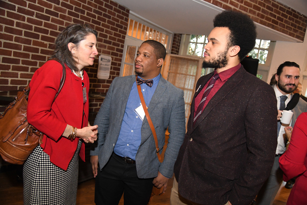 Phoebe Stein, left, executive director of Maryland Humanities, chats with Dayvon Love and Adam Jackson, both members of Leaders of a Beautiful Struggle, at the 15th annual Annapolis Summit in Annapolis. (Photo by Maximilian Franz)