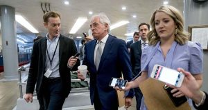 Sen. Bob Corker, R-Tenn., reacts as he speaks to reporters as he walks towards the Senate as Congress moves closer to the funding deadline to avoid a government shutdown on Capitol Hill in Washington, Thursday, Jan. 18, 2018. (AP Photo/Andrew Harnik)