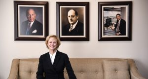 1-9-18 Towson, MD- Debora B. Cruz, Esquire, new managing partner at Levin & Gann, P.A., seen here sitting on a couch under portraits of their founding partners Stanford Gann, Sr (left), Ellis Levin, and Calman Levin.   (The Daily Record/Maximilian Franz)