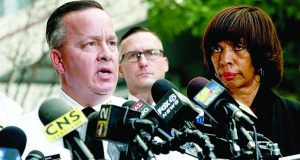 In this Nov. 16, 2017 file photo, Baltimore Police Department Commissioner Kevin Davis, left, speaks alongside Mayor Catherine Pugh at a news conference outside the R Adams Cowley Shock Trauma Center in Baltimore. Pugh has replaced the city's police commissioner, saying a change in leadership is needed to reduce crime.  A news release from the mayor's office Friday, Jan. 19, 2018,  says Deputy Commissioner Darryl DeSousa will take Kevin Davis' place. The release says DeSousa, a 30-year veteran of the force, will assume responsibility immediately.   (AP Photo/Patrick Semansky, File)