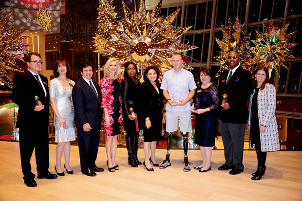 Award winners from the inaugural Melwood Ability Awards gather for a group photo at MGM National Harbor. From left, Nelson A. Carbonell and Michele Carbonell, founding donors of the George Washington University Autism and Neurodevelopmental Disorders Institute; Kevin A. Pelphrey, Ph.D., director of the institute; Peggy Fox, a news anchor with WUSA-TV, channel 9 and emcee for the event; Charnetia Young, an adviser of workforce initiatives in pharmacy services for CVS Health; Cari DeSantis, president and CEO of Melwood; Rob Jones, a U.S. Marine Corps veteran and featured speaker for the event; Linda Chandler, president and CEO of  Linden Resources in Arlington, Virginia; and Don Thompson, owner of Don's Café in Hyattsville; and Tracy Wareing Evans, the executive director of the American Public Human Services Association and chair of Melwood's board of directors. (Photo by Ayesha Khwaja)