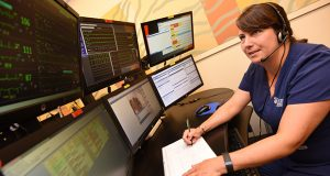 Cynthia Cosgrove, RN, Critical Care Nurse monitoring patients in the UMMC Tele ICU. (The Daily Record / Maximilian Franz)