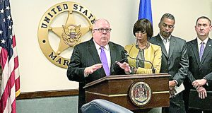 Gov. Larry Hogan speaks Wednesday during a news conference at the Edward A. Garmatz U.S. District Courthouse touting the success of a crime crackdown in Baltimore. Joining Hogan on stage were Baltimore Mayor Catherine Pugh, Baltimore Police Commissioner-designate Darryl De Susa and Danny Board, a Baltimore field division special agent in charge with the U.S. Bureau of Alcohol Tobacco and Firearms. (Photo by Adam Bednar)