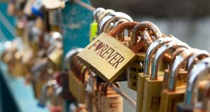 A Virginia judge says under a 1919 law, he will impanel a special grand jury to determine whether so-called 'love locks,' placed by couples on a city pedestrian bridge as testimony to their feelings for each other, constitute a public nuisance. (Deposit Photos)