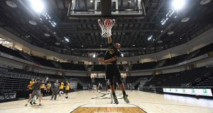Jarius Lyles, #10 for the UMBC Retrievers Men's Basketball team, makes a dunk shot during practice in their new UMBC Event Center.  (The Daily Record / Maximilian Franz)