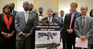 Sen. Robert Zirkin, a Democrat, talks about measures aimed at protecting Maryland residents from gun violence during a news conference with Democrats in Annapolis, Md., on Thursday, Feb. 1, 2018. Del. David Moon, far right in front, is sponsoring a bill to ban bump stocks, devices that enable rapid-fire shooting similar to fully automatic weapons. Sen. Richard Madaleno, left of Moon, is sponsoring a bill to repeal the state's Handgun Permit Review Board, which is comprised of five members appointed by the governor, and turn decisions over appeals for wear and carry permits over to administrative law judges. (AP Photo/Brian Witte)