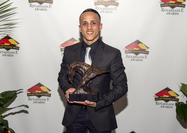 Jevian Toledo shows off his Jockey of the Year award presented to him at the Sagamore Pendry hotel during the inaugural Renaissance Awards. (Photo by Jerry Dzierwinkski, Maryland Horse Breeders Association)