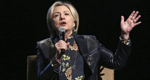 """FILE - In this Dec. 15, 2017 file photo, former Secretary of State and presidential candidate Hillary Clinton speaks to the GirlsBuildLA Leadership Summit in Los Angeles.   Clinton will speak at this year's Class Day at Yale University. Class Day is an annual event at the New Haven, Connecticut, university that honors achievements in academic, artistic and athletic fields. Past notable speakers include former Secretary of State John Kerry and former Vice President Joe Biden in 2015. In a statement Monday, Feb. 26, 2018, Class Day co-chair and Yale student Josh Hochman says students should emulate Clinton's """"life of resilient and courageous service.""""  (AP Photo/Reed Saxon)"""