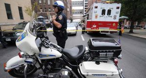A police officer responds to a 2010 incident at Johns Hopkins Hospital.  (Maximilian Franz/ The Daily Record)