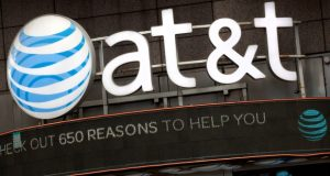 The AT&T logo is positioned above one of its retail stores in New York in October 2016. Opening statements in the federal government's case to block AT&T's efforts to gobble up Time Warner are scheduled for Thursday. (Mark Lennihan/AP file photo)